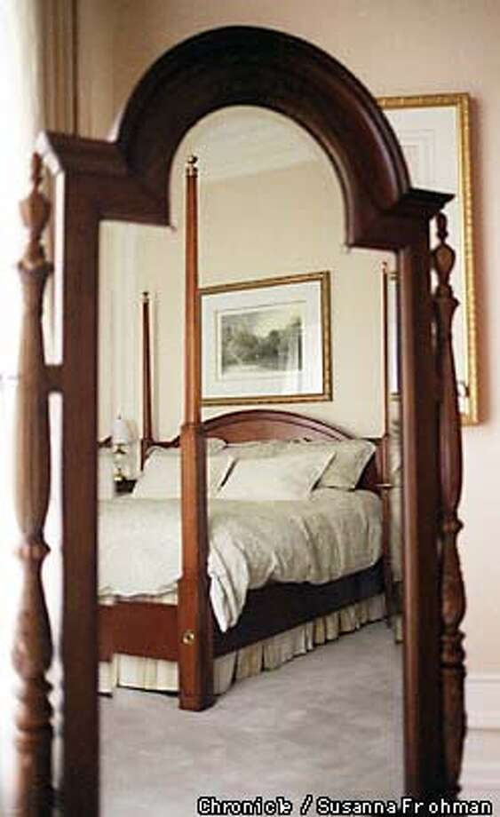 =The bed in the masterbedroom of the Palace Hotel's Presidential Suite is reflected in a large standing mirror. BY SUSANNA FROHMAN/THE CHRONICLE Photo: SUSANNA FROHMAN