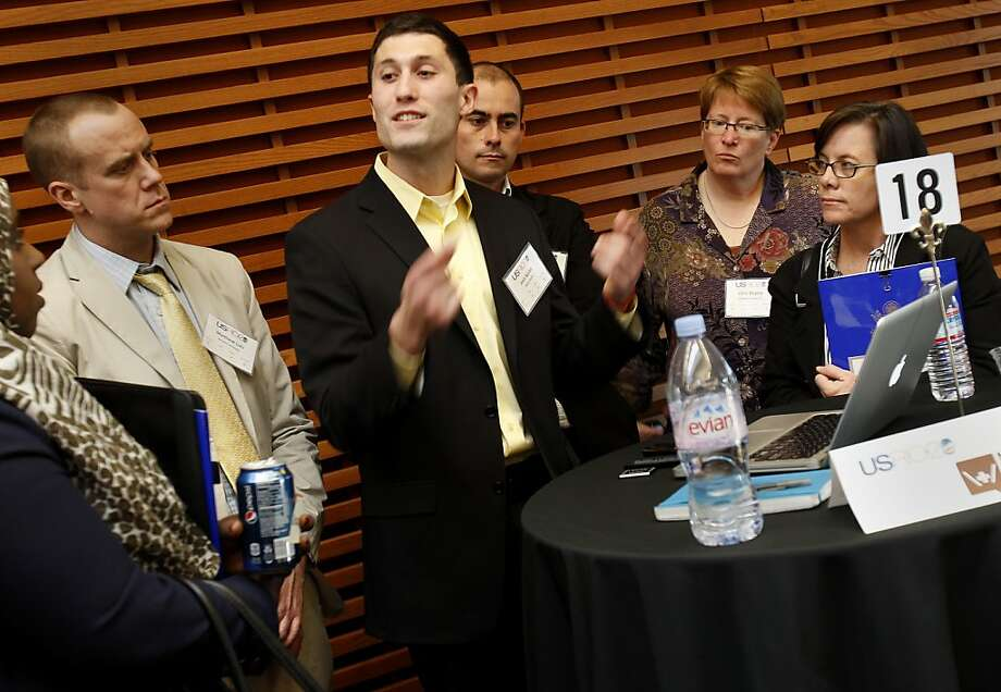 "Josh Nesbit (center) of Medic Mobile, a local company, showed off his company on his Apple laptop. The U.S. State Dept. is hosting a conference at Stanford University this weekend to discuss how connection technologies can be used to advance sustainable development solutions in health, environment, and economics. Using ""Demo Alley Speed Geeking"" twenty-six companies get five minutes each to show their stuff to attendees on laptops. Photo: Brant Ward, The Chronicle"
