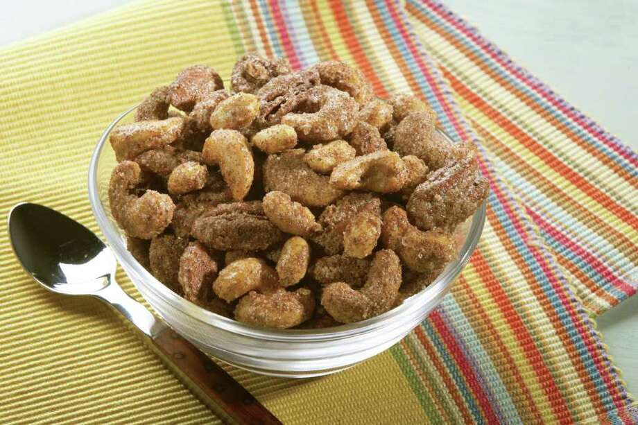 Snack on  healthy foods, such as sweet and spicy nuts — but  not   before lunch. Photo: Michael Pohuski / handout