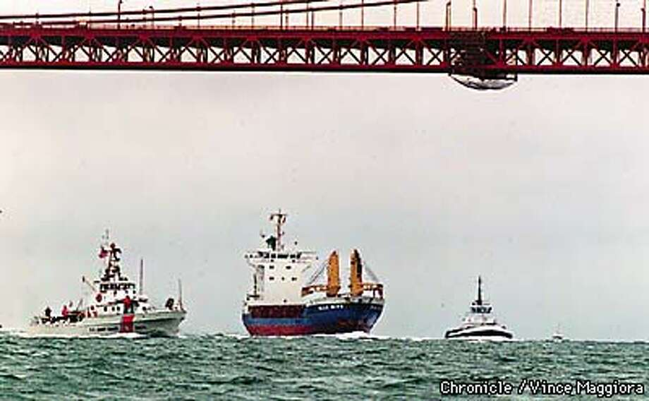 BLUE BIRD the ship carrying the spent fuel arrives under the GG bridge with two tugs and the Coast Guard by Vince Maggiora Photo: VINCE MAGGIORA