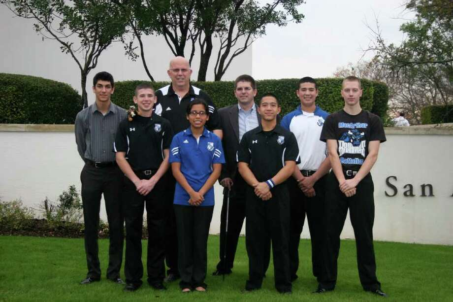 Its first time competing in the tournament, the McArthur High School Army JROTC team (from left: Samuel Burgess, Robert Isenhour, Bob Blake (coach), Lois Agabon, Corey King (mentor), Adam Cruz, Andy Banda, Peter Myers) has made it to the Cyber Patriot finals in March. The group is the only service division team in Texas to make the finals. Photo: COURTESY PHOTO / McArthur High School Army JROTC