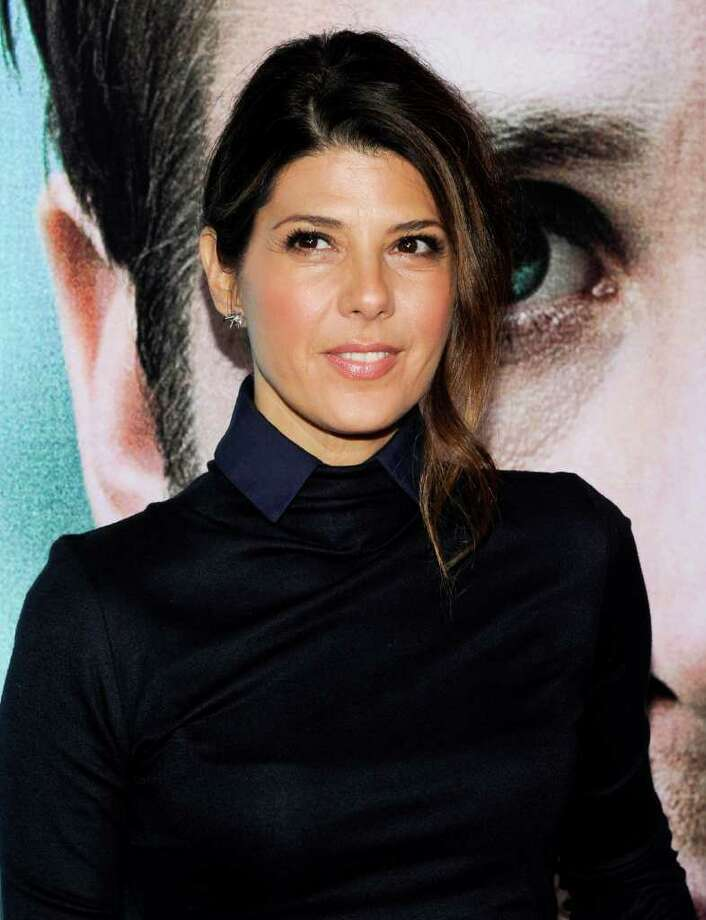 """FILE - In this Wednesday, Oct. 5, 2011 file photo, actress Marisa Tomei attends the premiere of """"Ides of March"""" at the Ziegfeld Theatre in New York. A lawsuit claims a leak from Marisa Tomei's New York City apartment has damaged the homes of two downstairs neighbors, including director John Waters, Thursday, Feb. 2, 2012. (AP Photo/Evan Agostini, File) Photo: Evan Agostini"""