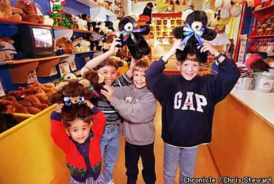 Four lucky new teddy bear owners show off their purchases at the Basic Brown Bear Factory at The Cannery, 2801 Leavenworth St., SF. (L-R) Chris Collins, 4; Matthew Collins, 9; Reid Calvert, 6; and Chase Calvert, 9. The Collins brothers are from Alamo and the Calvert brothers are from Austin, Texas. SAN FRANCISCO CHRONICLE PHOTO BY CHRIS STEWART Photo: CHRIS STEWART