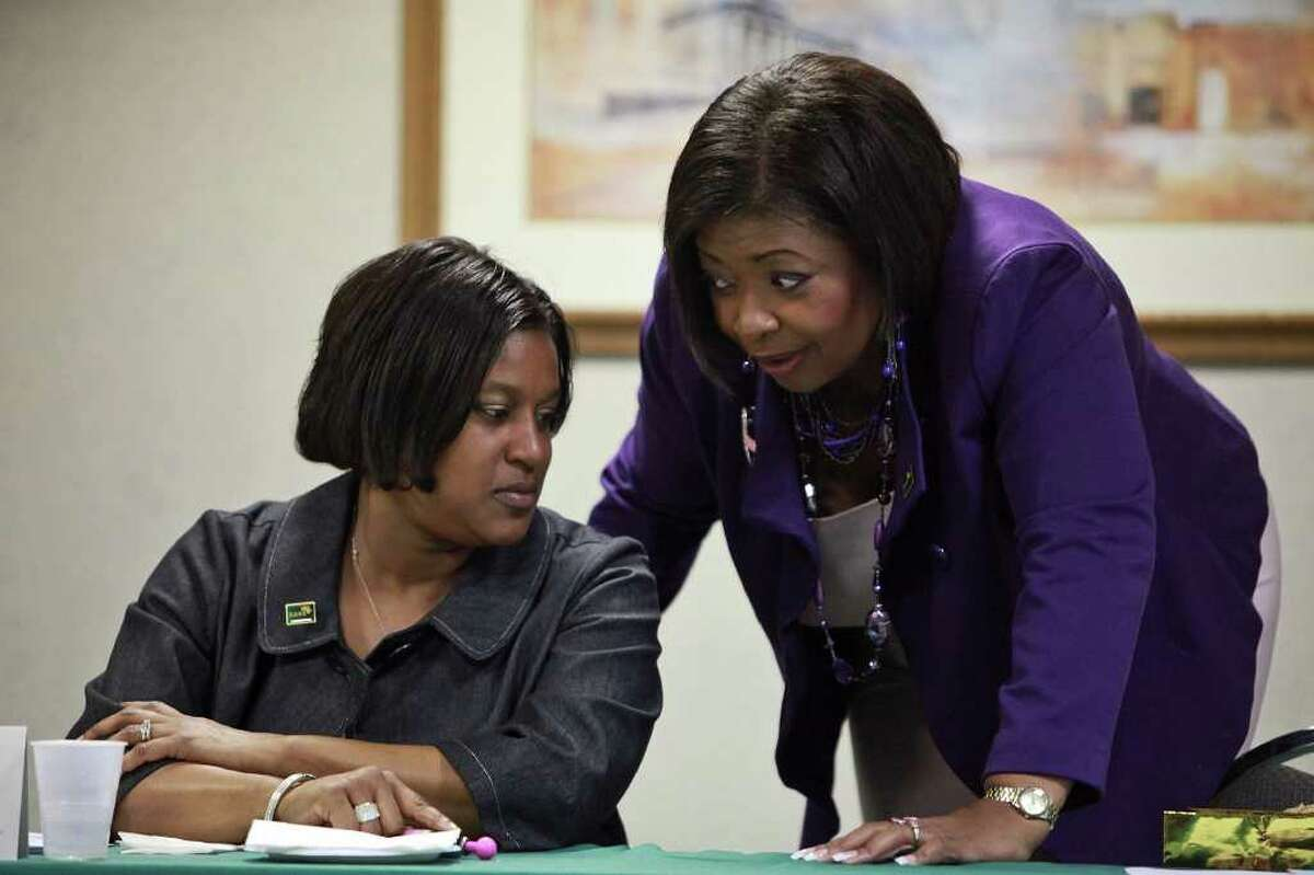 Jackie Gorman-Johnson, the Executive Director of SAGE (right), talks with her administrative assistant, Tara Jones, during the organization's board meeting on Friday, Jan. 27, 2012.