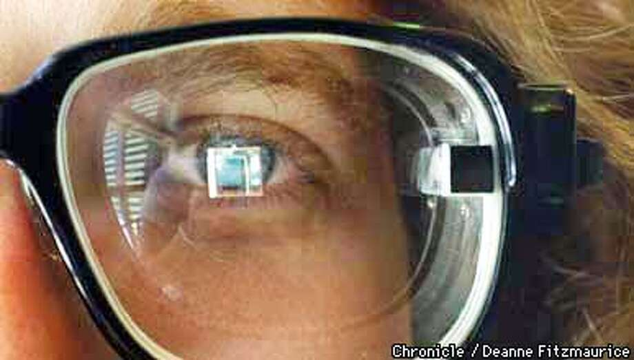 Thad Starner, PhD student at MIT Media Lab has a computer screen with access to the internet, e-mail, etc. in his perscription display eye glasses that were made by MicroOptical Corp. He is the first person to wear this as his primary eyeglasses. New technology and inventions were shown at IBM Almaden Research Center today. CHRONICLE PHOTO BY DEANNE FITZMAURICE