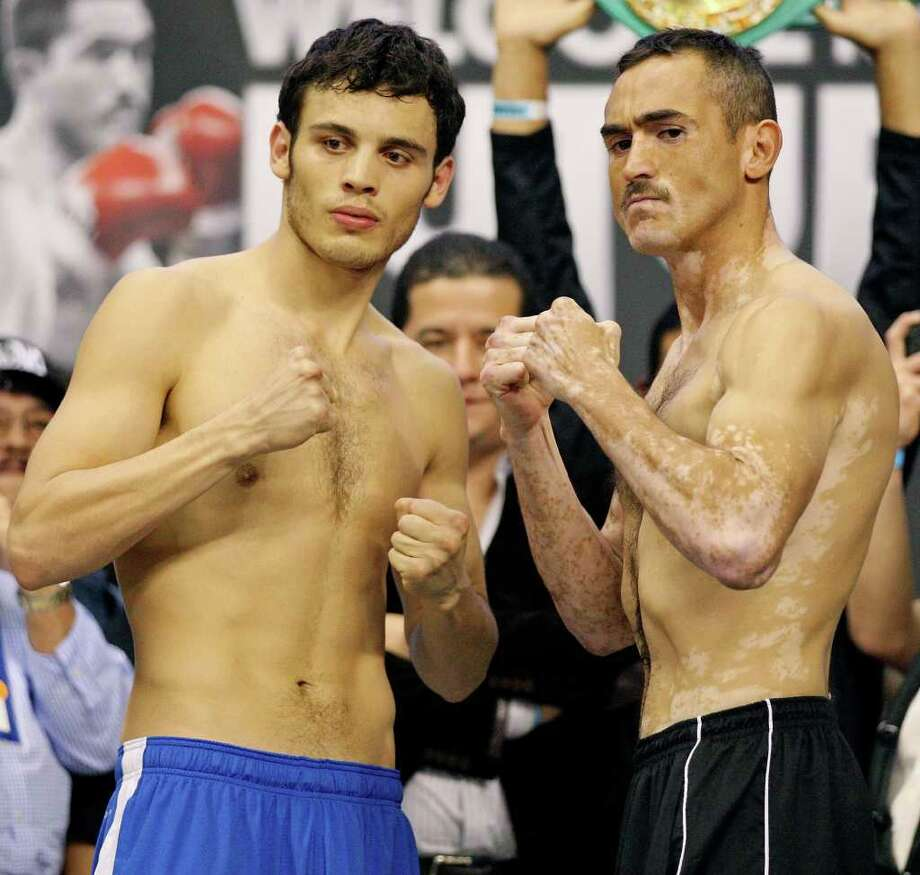 Julio Cesar Chavez, Jr. (left) and Marco Antonio Rubio pose for photos during the weigh-in Friday at the Alamodome. Photo: EDWARD A. ORNELAS, SAN ANTONIO EXPRESS-NEWS / © SAN ANTONIO EXPRESS-NEWS (NFS)
