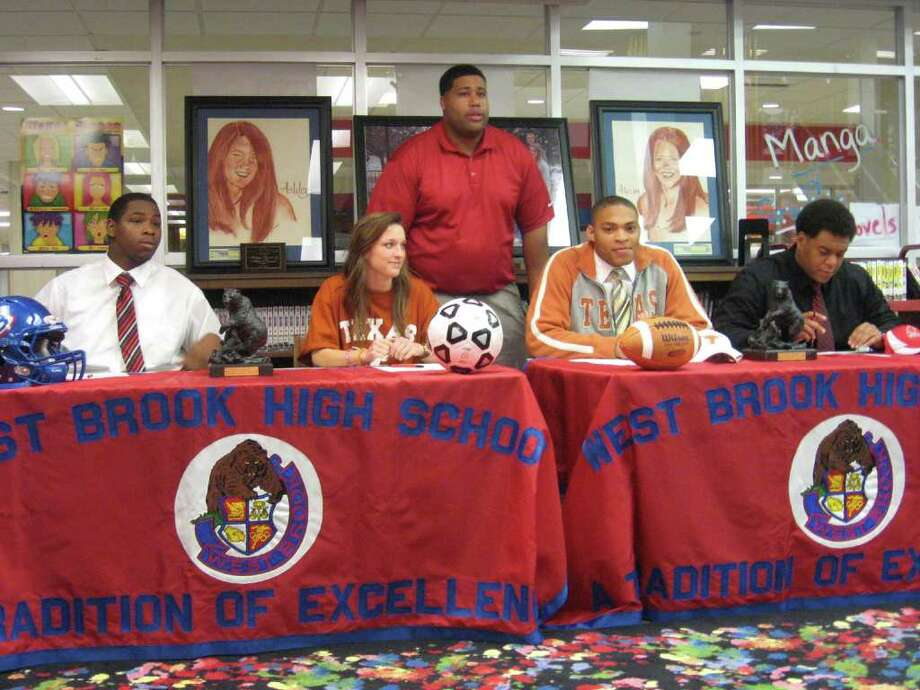 West Brook High School held a signing ceremony for four athletes signing with colleges on Friday. Pictured (from left to right are): Jared Castle, who will play football at Navarro College; Aaron Strawser, who will play soccer at Texas; Caleb Bluiett, who will play football at Texas and Jermaine Bowman, who will play football at Navarro Junior College. In the background is interim head football coach/campus coordinator Joe Bowser Photo: David Henry