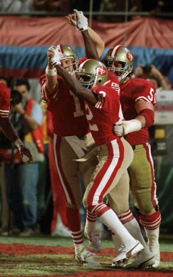 San Francisco 49ers quarterback Joe Montana (16) and wide receiver John Taylor (82) clasp hands after Montana's pass to Taylor at the end of the fourth quarter resulted in a 20-16 victory over the Cincinnati Bengals at Super Bowl XXIII Jan.22, 1989 in Miami. (AP Photo/Rusty Kennedy) Photo: Rusty Kennedy