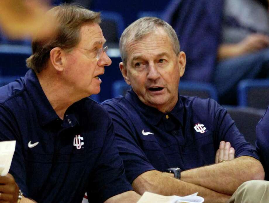 FILE - In this Nov. 7, 2010, file photo, Connecticut coach Jim Calhoun, right, speaks with associate head coach George Blaney during the second half of Connecticut's 103-57 victory over Bridgeport in an exhibition NCAA college basketball game in Hartford, Conn. Calhoun is taking an indefinite medical leave of absence, the school announced Friday, Feb. 3, 2012. Blaney will lead the team in Calhoun's absence (AP Photo/Fred Beckham, File) Photo: Fred Beckham, ASSOCIATED PRESS / AP2010