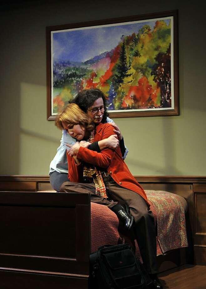 Joyce (Jeri Lynn Cohen, rear) and partner Phyllis (Amy Resnick) share a moment. Photo: David Allen