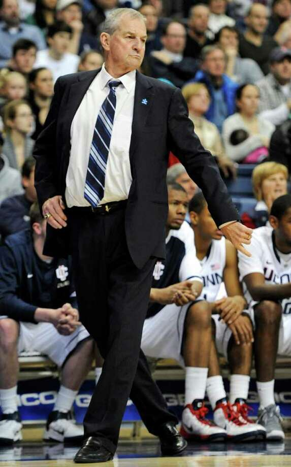 FILE - In this Jan. 18, 2012, file photo, Connecticut head coach Jim Calhoun reacts in the first half of an NCAA college basketball game against Cincinnati in Storrs, Conn. Calhoun is taking an indefinite medical leave of absence, the school announced Friday, Feb. 3, 2012. The Hall of Fame coach, who turns 70 in May, has been suffering for several months from spinal stenosis, a lower back condition that causes him severe pain and hampers mobility, the school said Friday in a news release. (AP Photo/Jessica Hill, File) Photo: Jessica Hill, Associated Press / AP2012