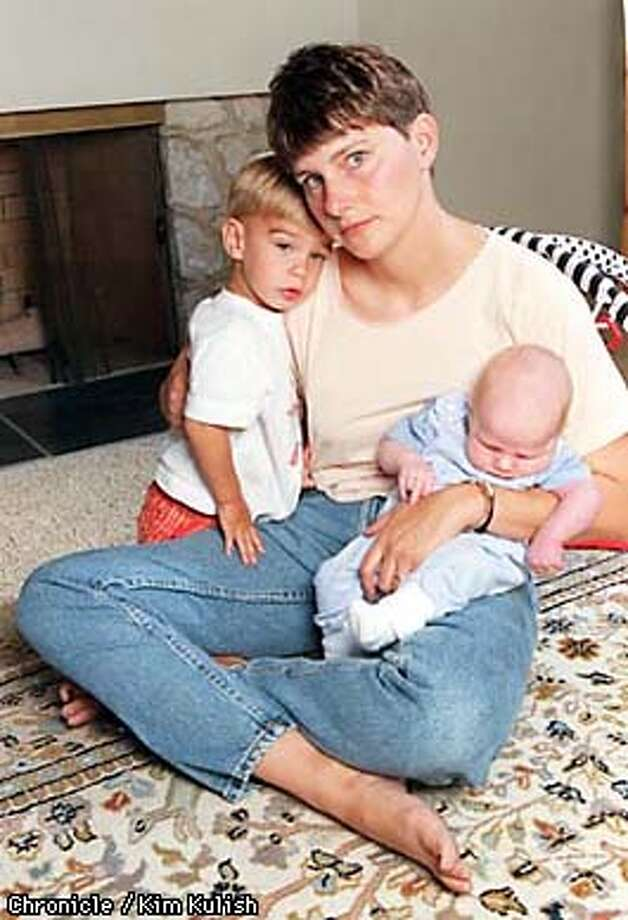 101 MAIN-MS/C/25JUN98/MN/KK--Michelle Scully, widow of John Scully, who was killed in the 101 California massacre, with her two sons from her second marriage at their San Pedro home. The boys are Frank Scully Hobus, 20 months and Ryan Thomas Hobus, 5 weeks. PHOTO BY KIM KULISH/FOR THE CHRONICLE