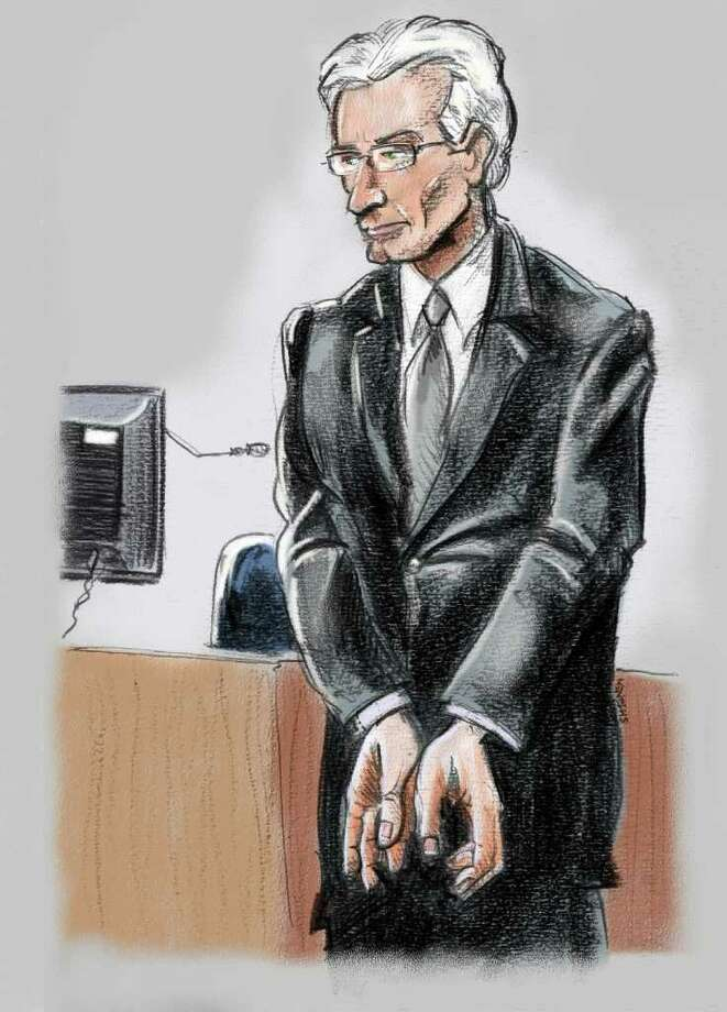 This courtroom sketch shows Former Stanford CFO James Davis, replicating for jurors the handcuffing motion he used to make to warn R. Allen Stanford that what they were doing was illegal Thursday, Feb. 2, 2012 in Houston, Texas. Davis, who pled guilty for his part in a $7 billion Ponzi scheme headed by Stanford, testified against the Texas tycoon during Stanford's fraud trial in Houston on Thursday. Photo: AP