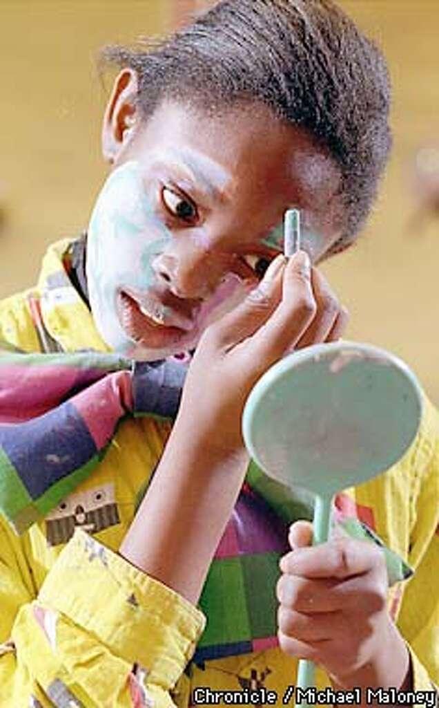 ... eleven year old tashika boston applies make up the prescott elementary clown austin makeup cles makeup ...