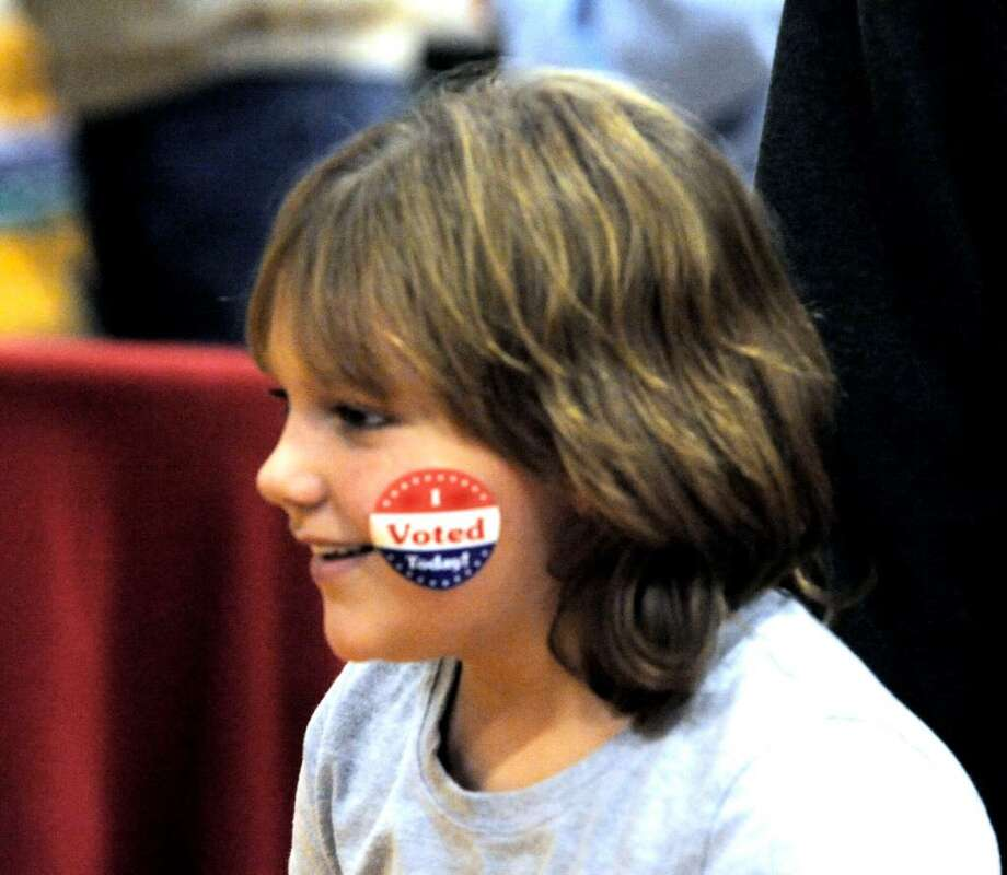 Katie Capossela, 7, leaves Brookfield High School polling station with a sticker on election night, Tuesday, Nov.3,2009. Photo: Michael Duffy / The News-Times