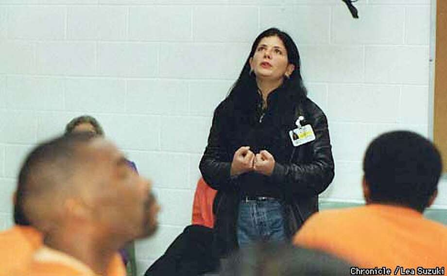 Angel Cassidy, HIV prevention case manager with Glide Memorial, talks with inmates at SF County Jail #7 in San Bruno about her experiences with violence as part of the R.S.V.P. program. Photo By Lea Suzuki Photo: LEA SUZUKI