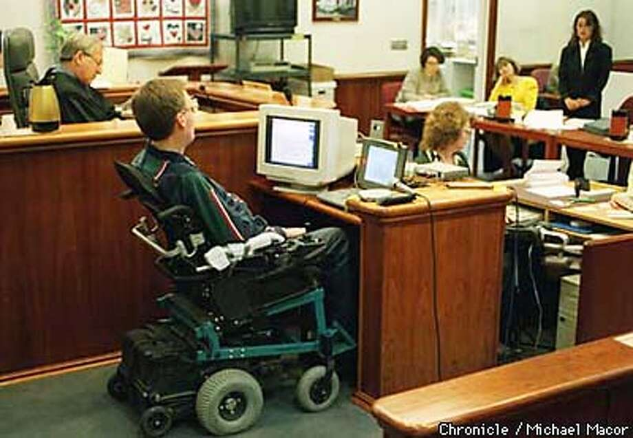 Dennis Eldridge (in wheelchair) who is dying og Lou Gehrig's Disease, testifies in a special hearing to preserve his testimony for his wfie Yvonne Eldriged facing a new trial after being convicted of abising fragile infants in her care. Eldrige used a infra-red device to spell out words and form sentences to respond to questions. Judge James Marchiano, on the bech his wife Yvonne at the table, sits next to her attorney, standing, Zenia Gilg. By Michael Macor/The Chronicle Photo: MICHAEL MACOR