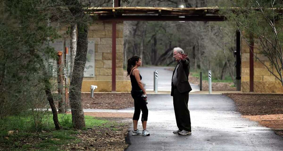 Former San Antonio Mayor Phil Hardberger, right, who is also the President of Phil Hardberger Park Conservancy, stops to talk with Mitsuko Ramos about the proposed Walmart that would back up to the nature park. Ramos uses the park every day for exercising. Friday, Feb. 3, 2012. Bob Owen/Express-News