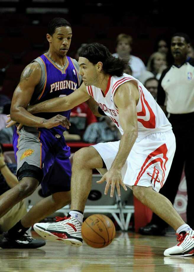 Houston Rockets' Luis Scola, right, pushes off Phoenix Suns' Channing Frye, left, in the first half of an NBA basketball game Friday, Feb. 3, 2012, in Houston. (AP Photo/Pat Sullivan) Photo: Pat Sullivan, Associated Press / AP