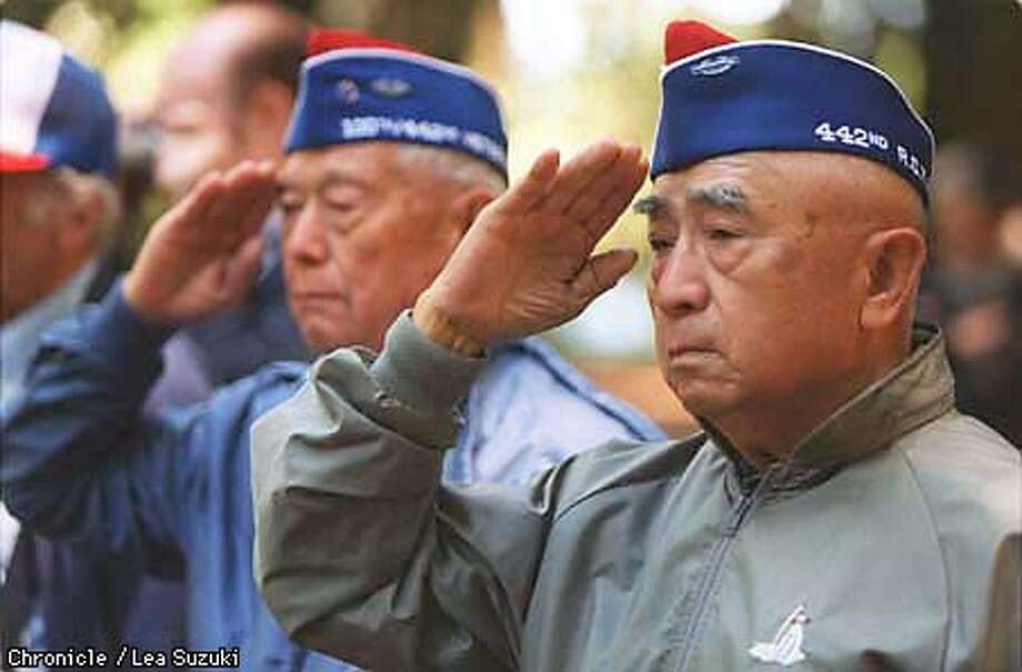 Frank Shimada of San Jose, Company I, 442nd; and Shig Doi of Richmond, Company I, 442nd; salute during the playing of Taps at the dedication of a memorial to Company E, 442nd Regimental Combat Team. PHOTO BY LEA SUZUKI Photo: LEA SUZUKI
