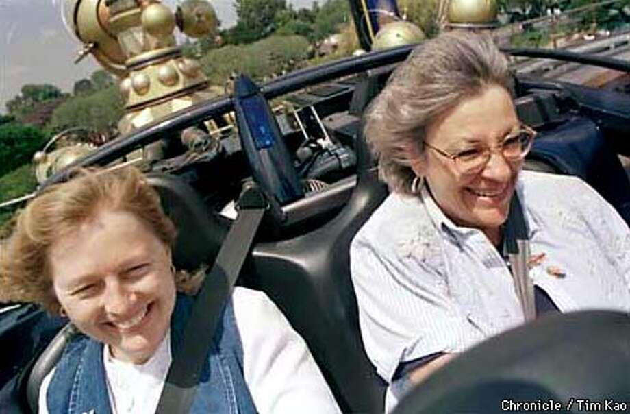 =(L-R) Kim Lievense and Betty Shultz were guests of Disney who got a preview of the 35mph top-speed Rocket Rods (I think that's what it's called) Thursday in Tomorrow Land. Both work for the Jet Propulsion Lab in Pasadena. photo by tim Kao/the chronicle