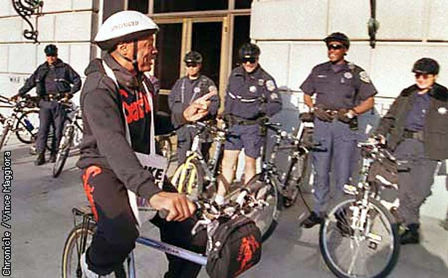=Mayor Willie Brown rides in front of the SFPD bike cops at city hall for bike to work day . by Vince Maggiora Photo: VINCE MAGGIORA