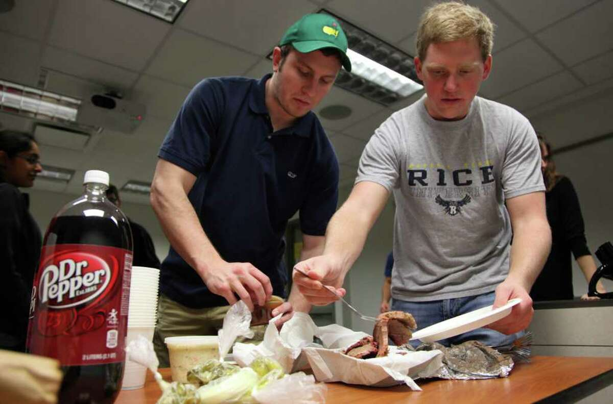 Jonathan Myers, 22, and Chris Roman, 21, serve themselves barbecue and Dr Pepper at Rice before settling down to a discussion of life that may involve chicken-fried steak, kolaches and a local drive-in restaurant.