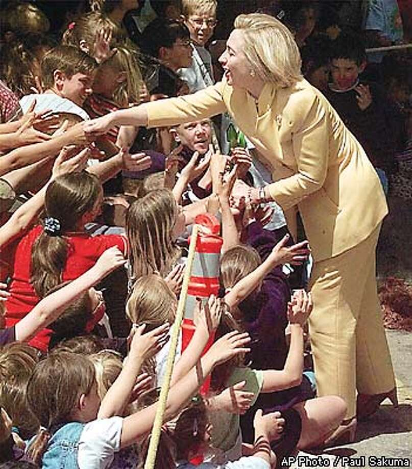 First lady Hillary Rodham Clinton shakes hands with school children from Greenbrook Elementary School in Danville, Calif. Tuesday afternoon, May 26, 1998 during a visit to the Kid's Country Child Care Center. (AP Photo/Paul Sakuma) Photo: PAUL SAKUMA