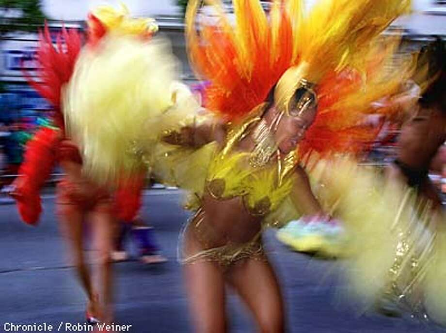Latanya Bradford of San Francisco dances with the Birds of Paradise during the Carnaval parade through the Mission. Robin Weiner/The Chronicle