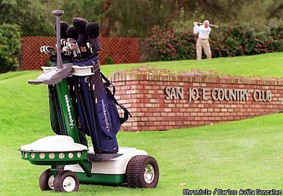 Santa Clara based Golf Pro International is developing a robotic caddy that uses several microprocessors, sonar, and a Global Position Satellite system to follow a golfer around a course. The San Jose Country Club will be the first club in the world to offer the Intelecaddy, which can caddy for two golfers. The caddy follows a transmitter beacon which the golfer has clipped to his belt and is programmed to avoid course hazards and to stay off the greens. (CHRONICLE PHOTO BY CARLOS AVILA GONZALEZ) Photo: CARLOS AVILA GONZALEZ
