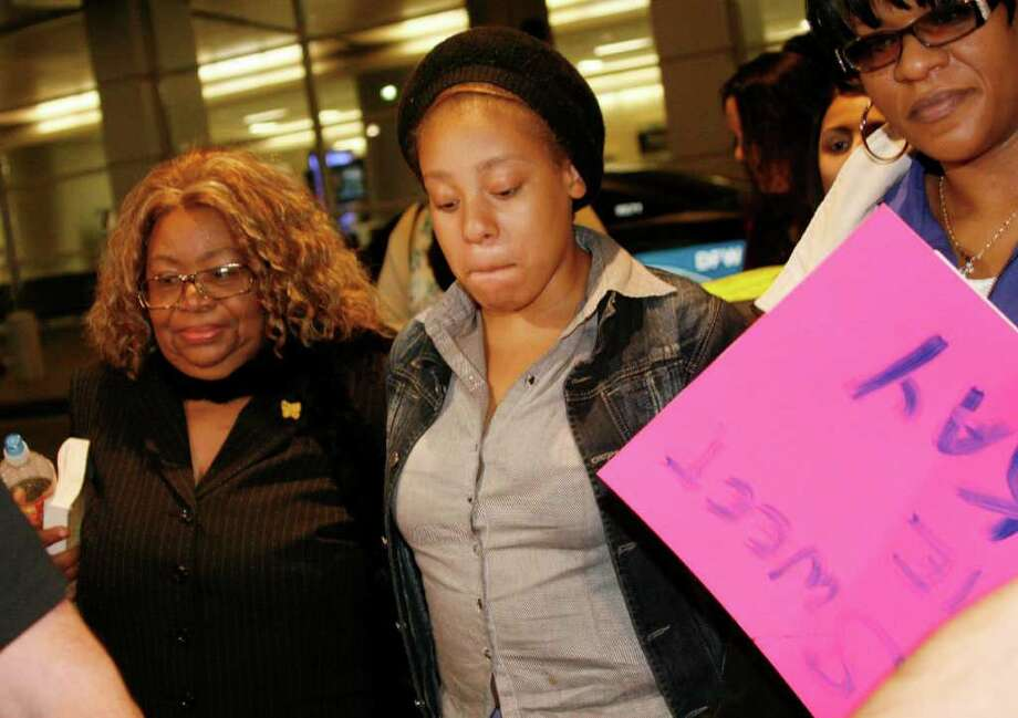 Jakadrien Turner, 15, center, is greeted by her grandmother, Lorene Turner, left, and her mother, Johnisa Turner, right, after returning to Dallas from Colombia in January. Photo: Mike Fuentes / FR103746 AP