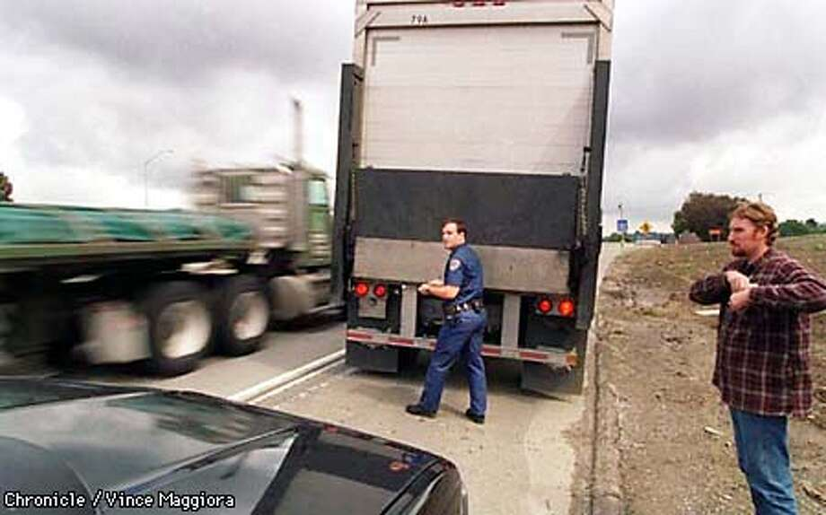 = CHP OFFICER John Tyler checking on a big rig in the East Bay, CHP three day crack down on big rigs . by Vince Maggiora Photo: VINCE MAGGIORA