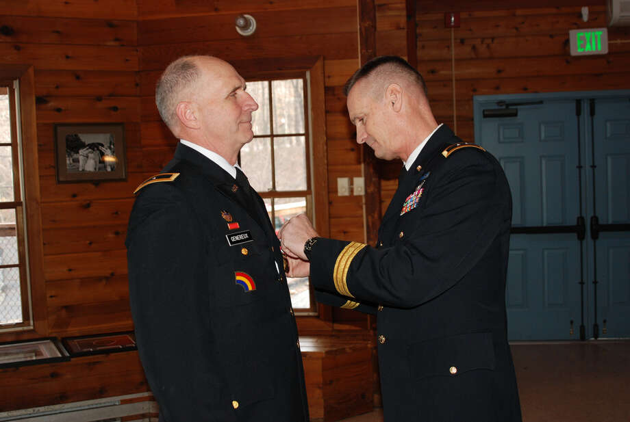 Brigadier Gen. Paul Genereux, assistant adjutant general of the New York Army National Guard, received a Distinguished Service Cross during his retirement testimony after nearly 40 years of military service.