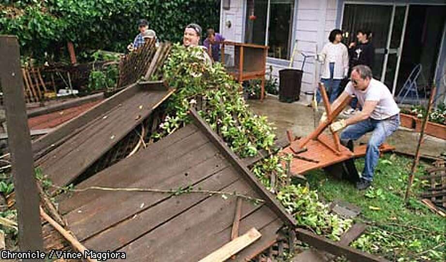 = Tom Conlee center with hat lifting the fence in the back yard of 1122 Plymounth Dr.and Patrick Spencer with white shirt are with the Abundant Life Assembly Of God church helping people clean up the storm damange ,Sunnyvale. by Vince Maggiora Photo: VINCE MAGGIORA