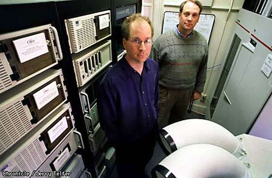 ALEXA/C/06MAY98/BU/JLT Alexa Internet co-founders Brewster Kahle (left) and Bruce Gilliat (both cq) amid the hardware their firm uses to archive the entire World Wide Web and provide a searchable database. The archive contains every web page since 1996, and currently requires 10 terabytes of storage space. SF Presidio - Bldg. 37 PHOTO BY JERRY TELFER Photo: JERRY TELFER