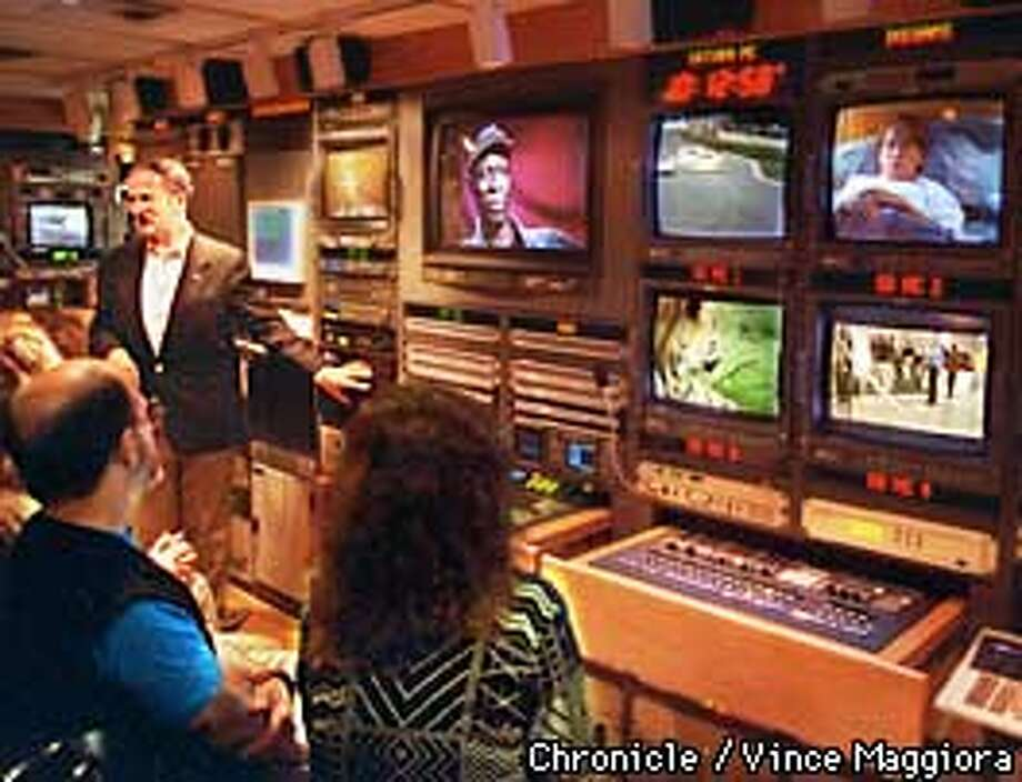 = Graham Jones talking about digital television on the station side in the DTV truck in the KQED garage SF. by Vince Maggiora Photo: VINCE MAGGIORA