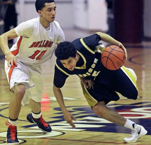 Edison's Artie Vela, who had 18 points, spins by Burbank's Jason Ainsworth on his way to the basket. Photo: TOM REEL, San Antonio Express-News / San Antonio Express-News