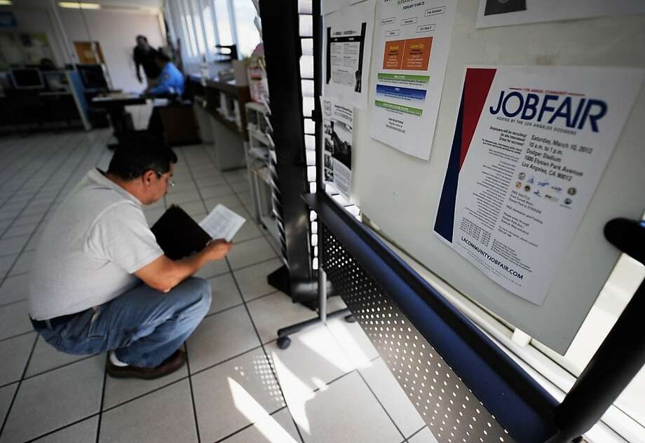 PASADENA, CA - FEBRUARY 03:  George Hernandez looks at job openings at the Foothill Employment and Training Connection on February 3, 2012 in Pasadena, California. According to report from the Labor Department US economy added 243,000 jobs in January dropping the unemployment rate to 8.3 percent.  (Photo by Kevork Djansezian/Getty Images) Photo: Kevork Djansezian, Getty Images