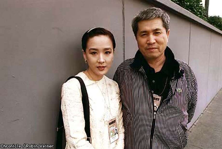 """Im Kwon-Taek, right, poses with Kang Soo-Yeon, left, the star of his film """"Sopyonje"""" outside the Kabuki Movie Theater where SFSU film students viewed the movie. Kwon-Taek is the recipient of the 1998 Akira Kurosawa Lifetime Achievement Award at the 41st San Francisco International Film Festival. Robin Weiner/The Chronicle"""