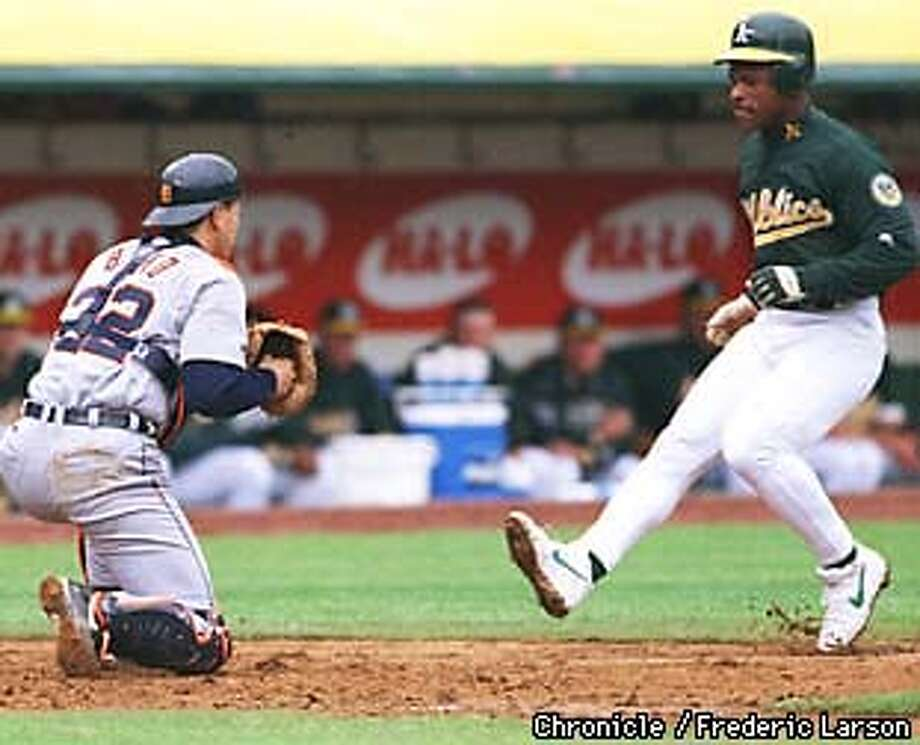 A's vs. Detroit. A's Rickey Henderson is out at home by a mile on an attempt to score from 3rd base as teammate Dave Magaden hits a fly ball to right field in the 3rd inning. Throw from right fielder Bobby Higginson of Detroit reached home in plenty of time for catcher, Gabor Bako. Home plate ump. Al Clark about to make the call. By Fredric Larson/The Chronicle Photo: FREDRIC LARSON
