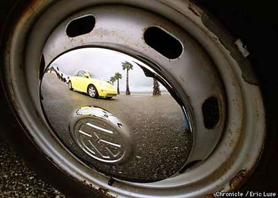 1998 Volkswagon Beetle feflected in the hubcap of a 1978 Beetle.  Photo by Eric Luse Photo: ERIC LUSE
