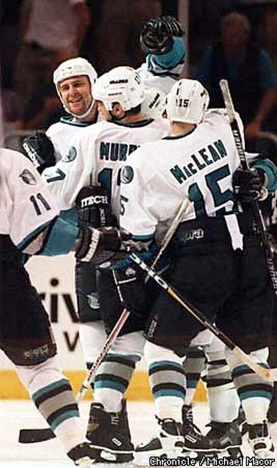 Sharks vs. Dallas Stars Game 3 Stanley Cup playoffs. Shark players swarm 43- Al Iafrate after his 3rd period goal. By Michael Macor/The Chronicle Photo: MICHAEL MACOR