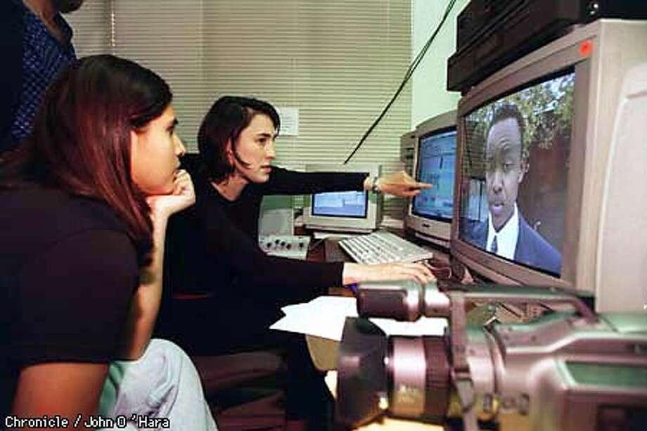 KBI INTERN RUTH SARAVIA LOOKED ON AS PRODUCER CARDINE CONEJERO, PRODUCER,EDITED A TV SHOW . PHOTO BY JOHN O'HARA