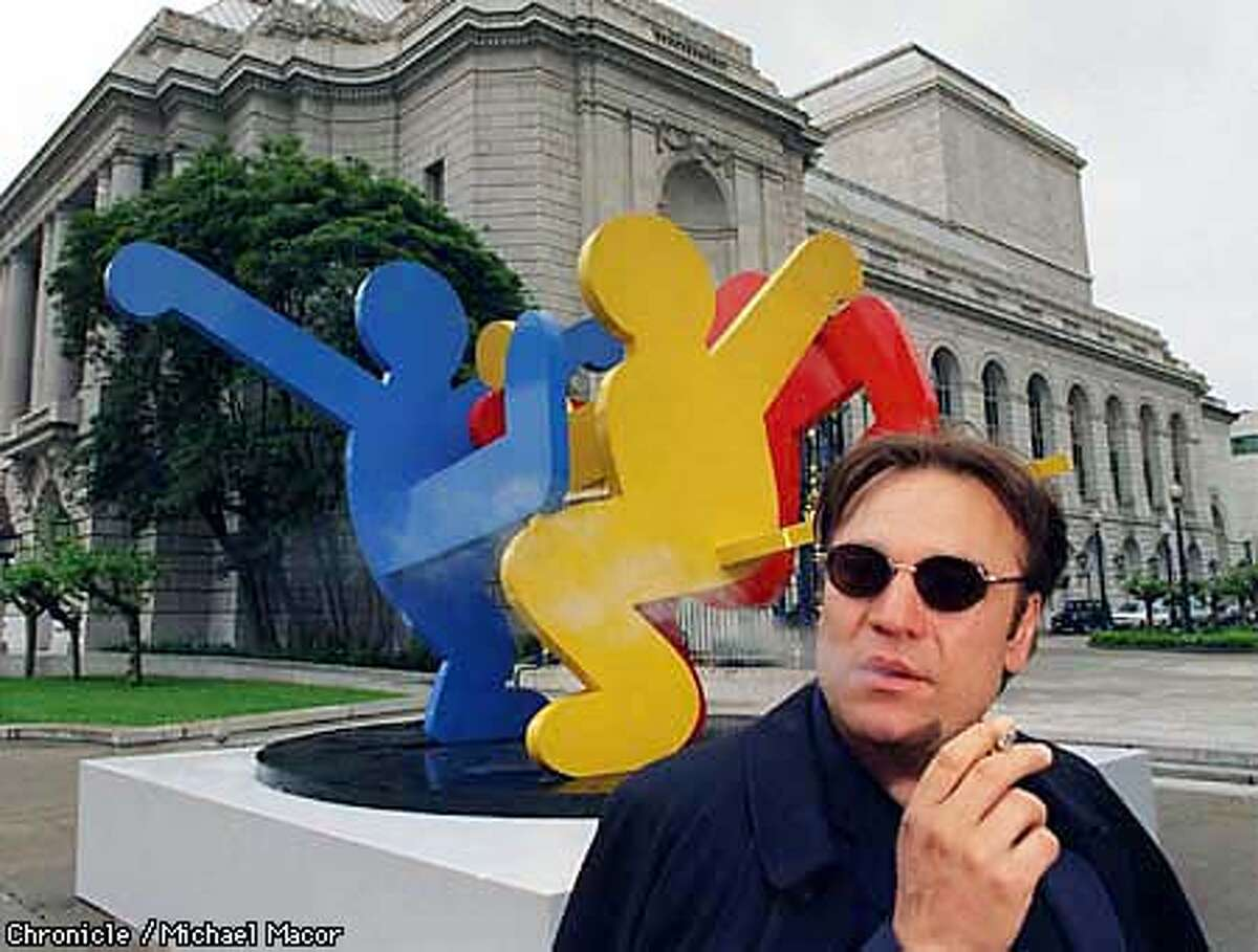"""Stanlee Gatti, San Francisco's Art Commission President in front of a steel sculpture by artist Keith Haring, """"Dancing Figures""""1989. This piece located between the Veterans Building and War Memorial Opera House on Van Ness Av. By Michael Macor/The Chronicle"""