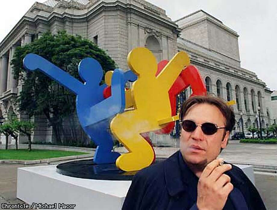 "Stanlee Gatti, San Francisco's Art Commission President in front of a steel sculpture by artist Keith Haring, ""Dancing Figures""1989. This piece located between the Veterans Building and War Memorial Opera House on Van Ness Av. By Michael Macor/The Chronicle Photo: MICHAEL MACOR"