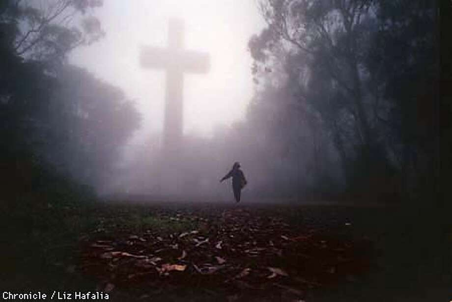 The cross on top of Mount Davidson during early morning fog. Liz Hafalia Photo: LIZ HAFALIA