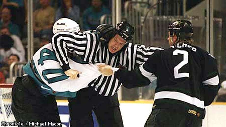 Sharks vs. Dallas Stars Game 3 Stanley Cup playoffs. Linesman- Mike Cvik breaks up a fight late in the game between Shark 40-Mike Rathje and Star 2- Derian Hatcher. By Michael Macor/The Chronicle Photo: MICHAEL MACOR