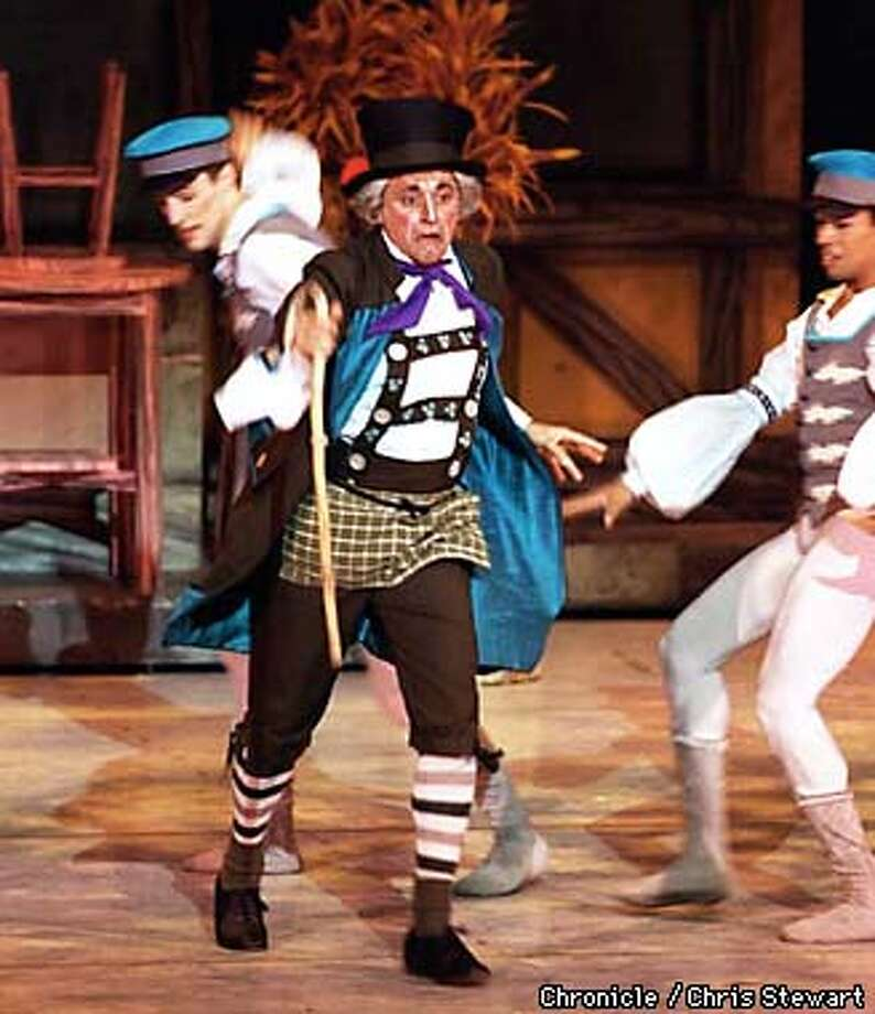 Dennis Nahat (C), the artistic director of the San Jose Cleveland Ballet, portrays Dr. Coppelius in the ballet Coppelia. In this scene he is harrassed by village youths who consider him crazy. SAN FRANCISCO CHRONICLE PHOTO BY CHRIS STEWART Photo: CHRIS STEWART