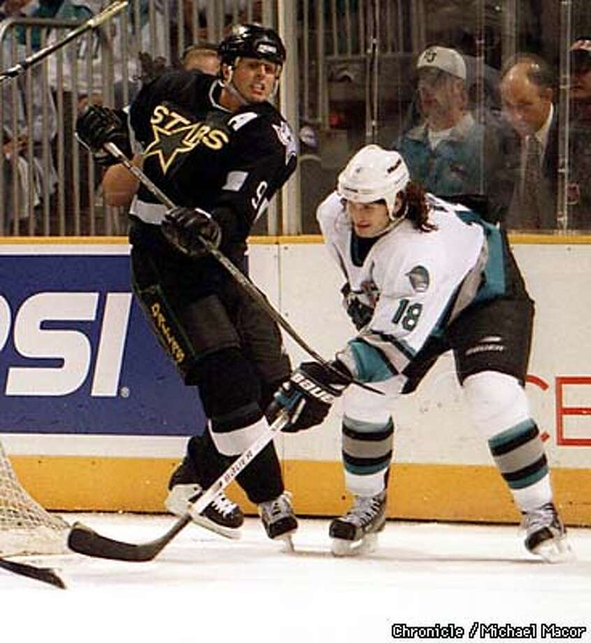 Sharks vs. Dallas Stars Game 3 Stanley Cup playoffs. Dallas Star 9- Mike Modano battles with Shark 18- Mike Ricci. By Michael Macor/The Chronicle Photo: MICHAEL MACOR