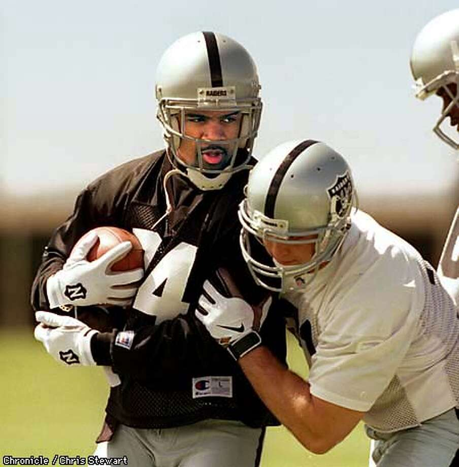 '97 Heisman winner and number one Raiders draft pick Charles Woodson (24) from the University of Michigan works out at the teams first mini-camp at its practice facility, 1220 Harbor Bay Parkway, Alameda. SAN FRANCISCO CHRONICLE PHOTO BY CHRIS STEWART Photo: CHRIS STEWART